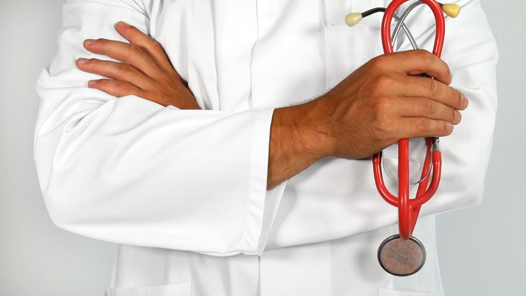 Doctor Crossing Arms About Health Law